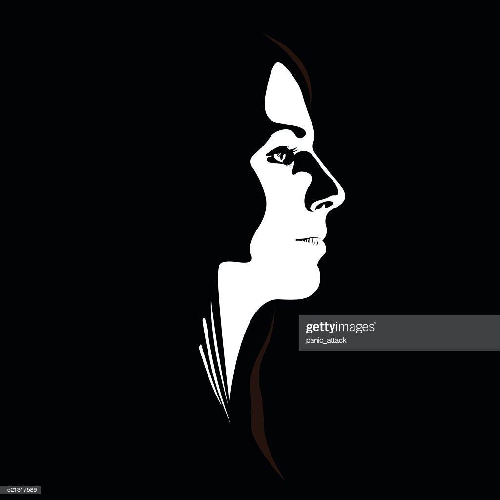 Woman face profile view. Low key