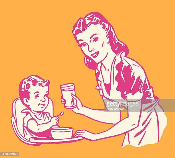 illustrations, cliparts, dessins animés et icônes de femme nourrir un enfant - assistante maternelle