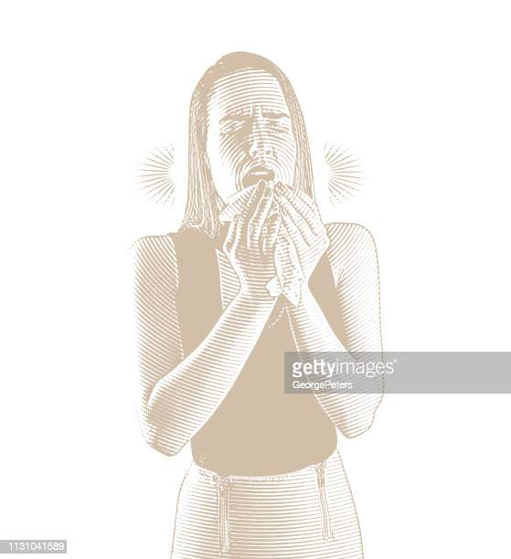 Woman feeling sick and sneezing