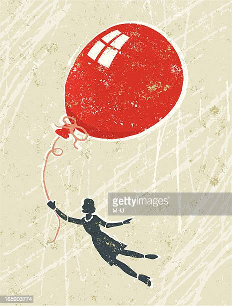 Woman floating with a Big Red Balloon