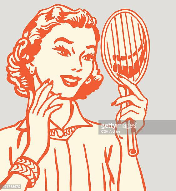 Woman Holding Hand Mirror