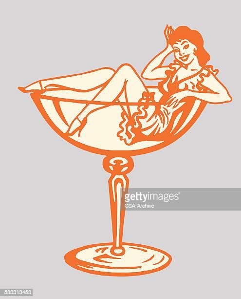 ilustraciones, imágenes clip art, dibujos animados e iconos de stock de mujer en el interior del vaso de cóctel - chicas de calendario