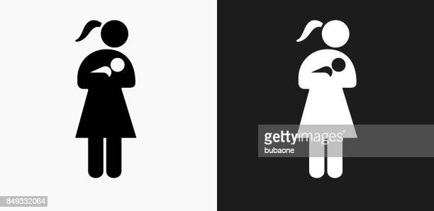 Woman Nursing a Baby Icon on Black and White Vector Backgrounds