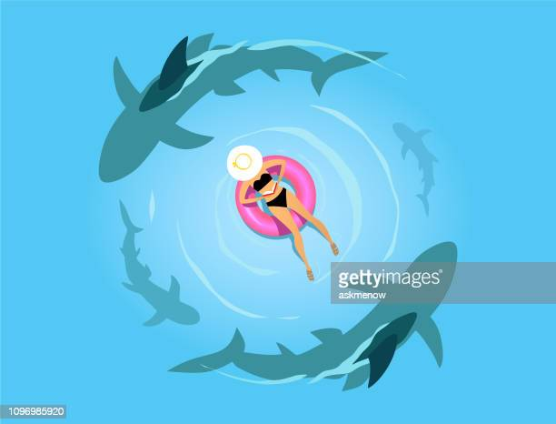 woman on the inflatable ring with sharks - sharks stock illustrations