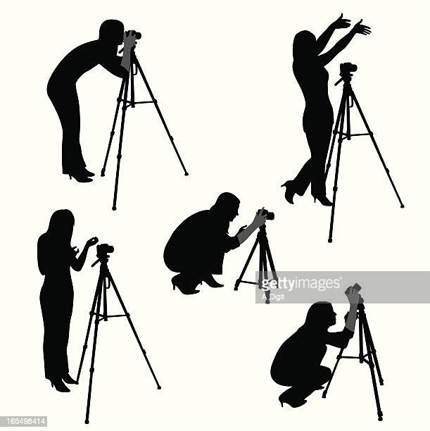 woman photographer vector silhouette - camera tripod stock illustrations, clip art, cartoons, & icons