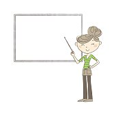 Woman pointing at whiteboard with a pointer