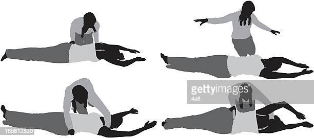 woman practicing yoga with instructor - yoga instructor stock illustrations, clip art, cartoons, & icons
