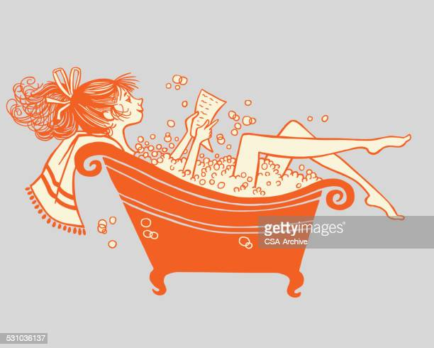 Woman Reading In Bubble Bath