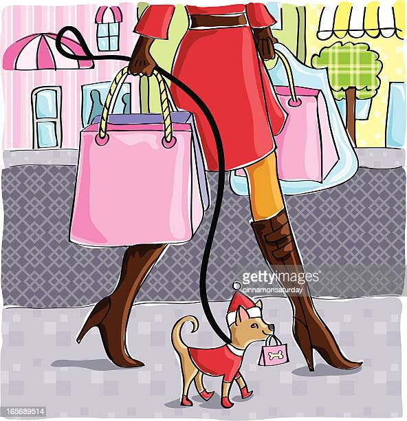Woman shopping and walking her little dog
