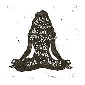 Woman silhouette sitting in lotus pose of yoga.