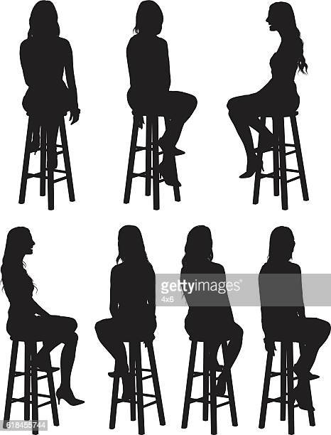 Woman sitting on stool