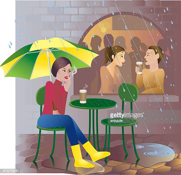 Woman Smoking and Sitting Outside Cafe in Rain
