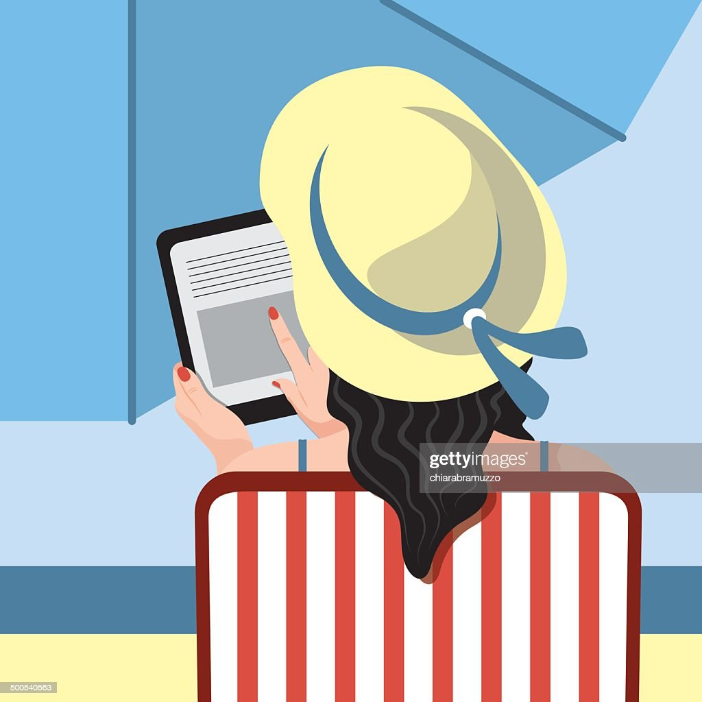 woman using tablet on the beach