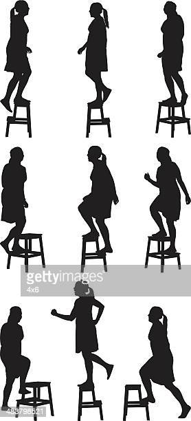 woman walking up steps on step stool - stepping stock illustrations, clip art, cartoons, & icons