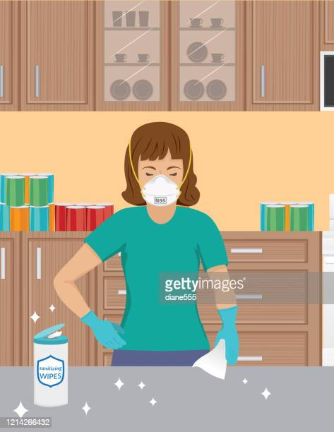 woman wearing an n95 mask cleaning her counter - woman wearing protective face mask stock illustrations