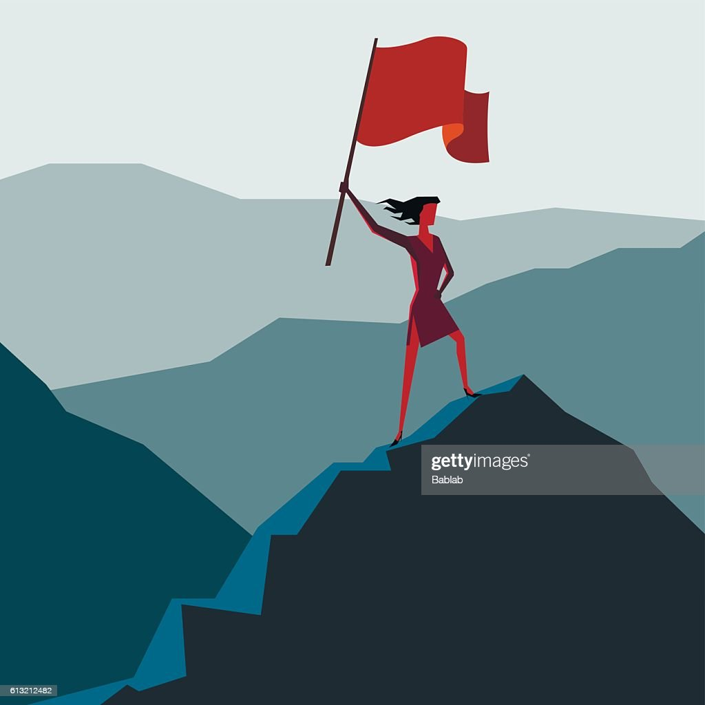 Woman with flag on a Mountain peak