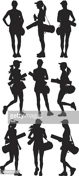 Woman with gym bag and exercising mat