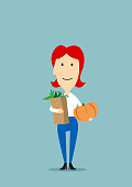 Woman with paper bag full of groceries