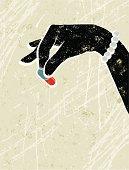 Woman's Hand Holding a Little Pill