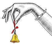 Woman's hand ringing retro bell