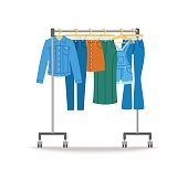 Women jeans clothes hanging on hanger rack