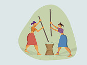 Women milling rice in the traditional way