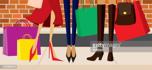 Women Shoppers with purses, shopping bags, high heels and boots