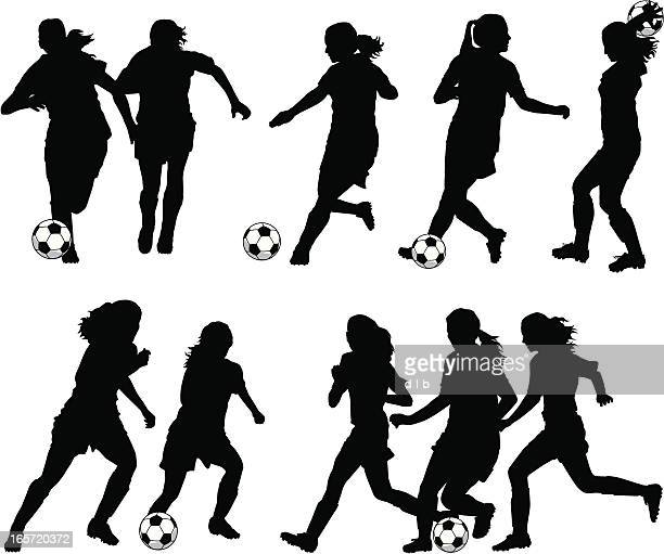 women soccer player silhouettes - football player stock illustrations