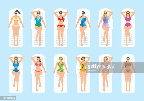 Women sunbathing on deckchairs