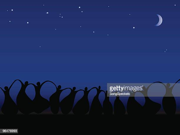 Women with arms raised in joy by Moonlight
