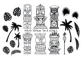 Wood Polynesian Tiki idols, gods statue carving, torch, palm trees, tropical leaves.