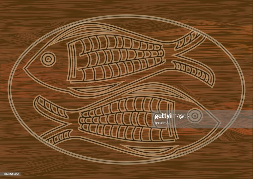 Wooden art, two fish carved into dark wood, symbol of christianity, Horoscope sign. Stzylized fish in oval frame.