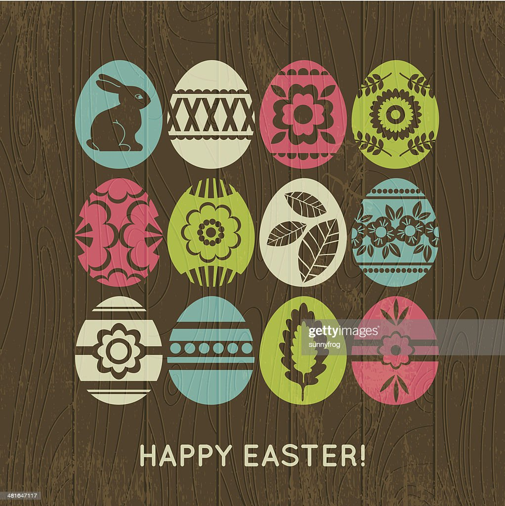 wooden background with color easter eggs