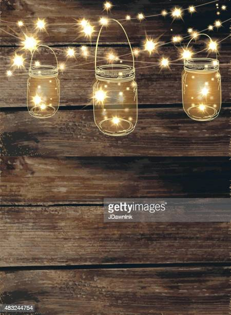 Wooden background with  jar and string lights