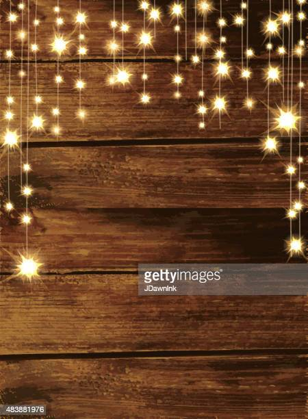 wooden background with string lights - illuminated stock illustrations