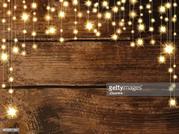 wooden background with string lights - sparks stock illustrations, clip art, cartoons, & icons