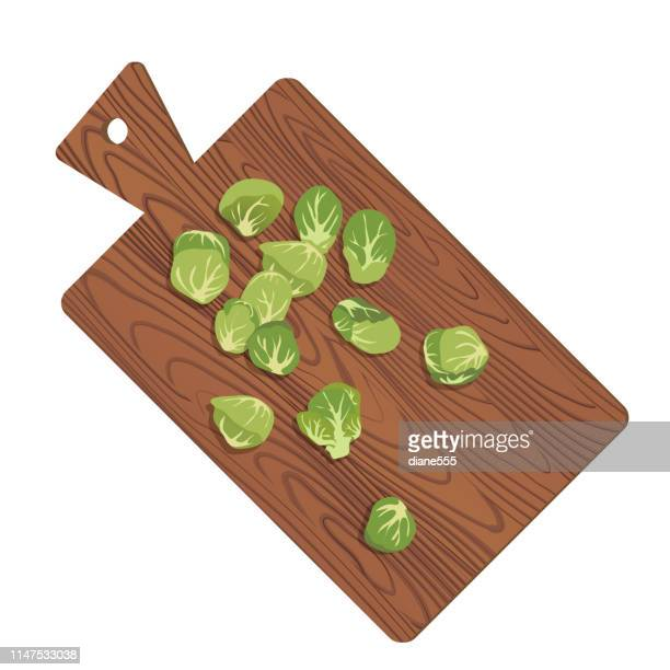 wooden cutting board with fresh brussels sprouts - brussels sprout stock illustrations, clip art, cartoons, & icons