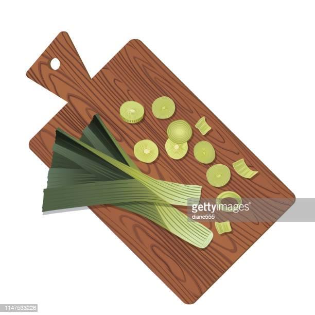 wooden cutting board with fresh leek - leek stock illustrations, clip art, cartoons, & icons