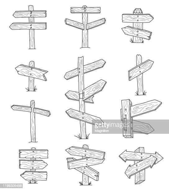 illustrazioni stock, clip art, cartoni animati e icone di tendenza di set doodles segni direzionali in legno e frecce - indicatore di direzione segnale
