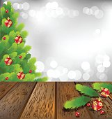 Wooden floor with Christmas tree on gray bokeh