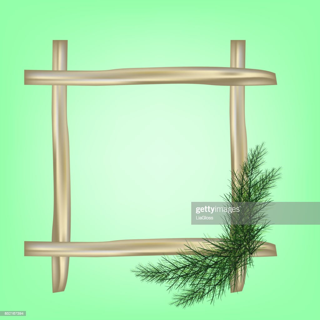Wooden Frame with Pine tree branches iSolated in the green background. Useful for a xmas greeting card or invitation
