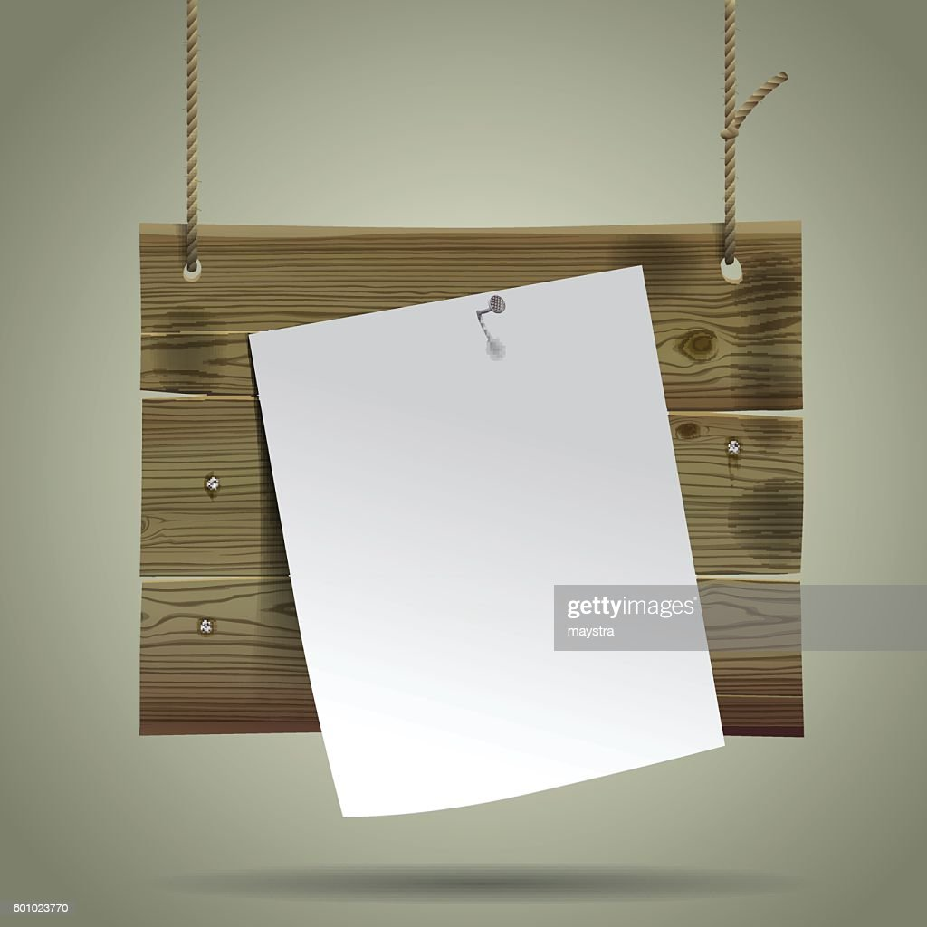 Wooden signboard suspended on a rope with a white paper sheet.