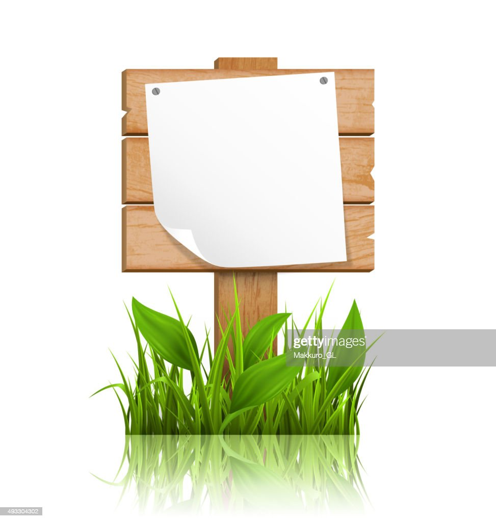 Wooden signpost with grass deflected paper and reflection