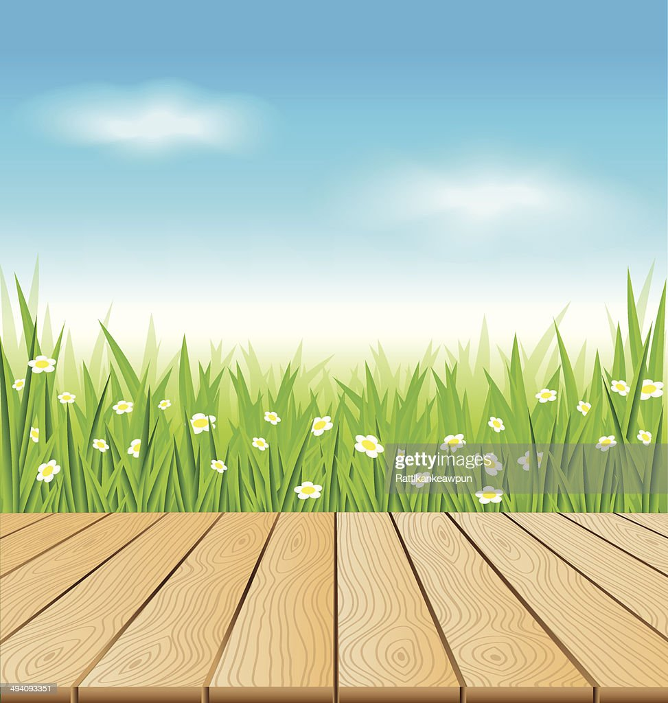 Wooden table on spring meadow