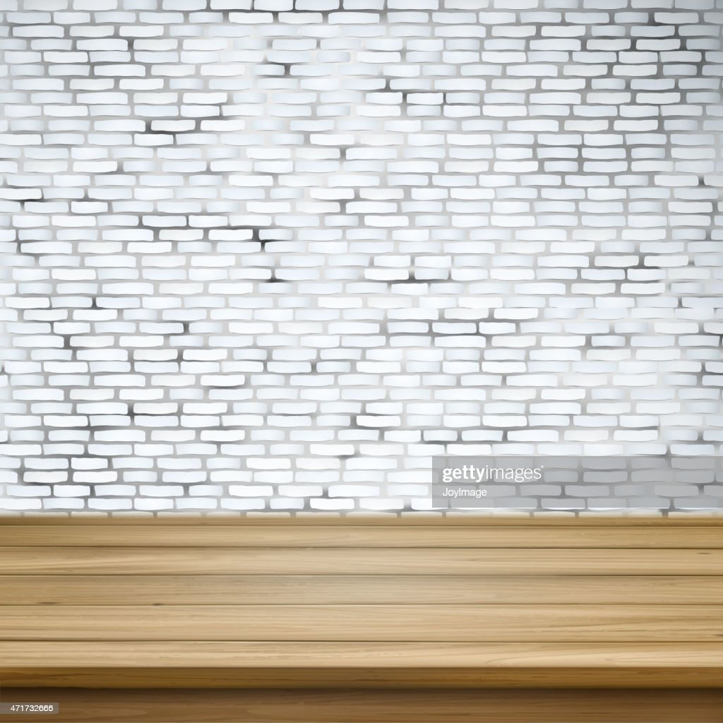 wooden table over white brick wall