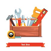 Wooden toolbox full of equipment