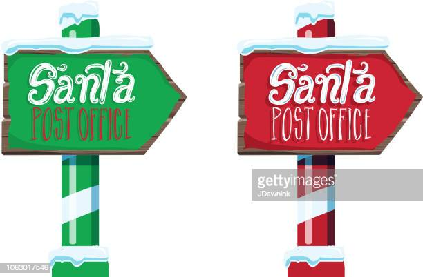 wooden winter christmas santa post office sign with handwriting or hand lettered text - post office stock illustrations, clip art, cartoons, & icons