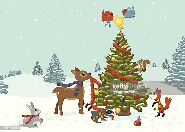 ilustraciones, imágenes clip art, dibujos animados e iconos de stock de woodland animales decorar un árbol de navidad - decorar
