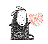 Woolly sheep sitting and heart