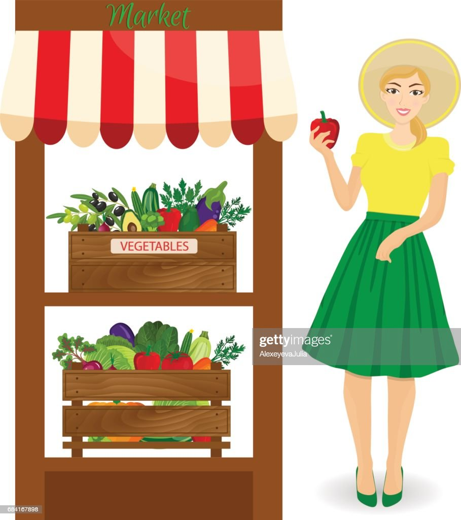 Worker of grocery store standing in front of section with vegetables. Female worker of grocery store holding a pepper.